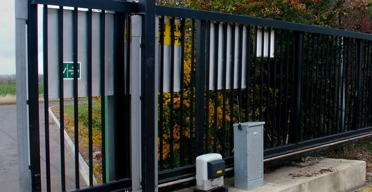 An engineer carrying out an electric gate maintenance in Rayleigh property, keeping things working 100% efficient